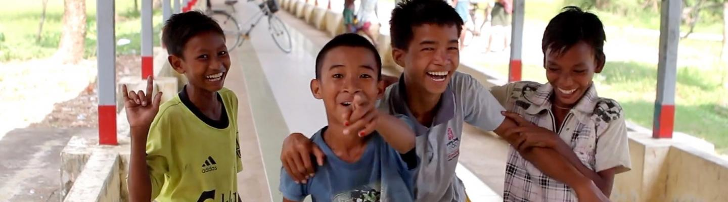 Four young boys laughing